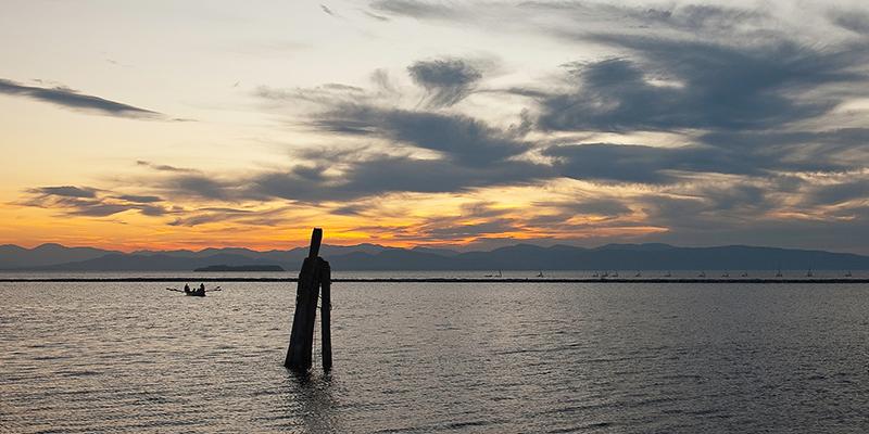 A boat on Lake Champlain at sunset