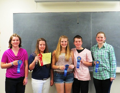 4-H members with blue ribbons