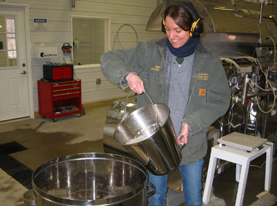 Abby van den Berg pours sap at Proctor Maple Research Center.