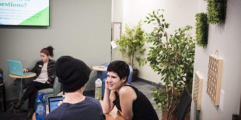 A pair of students meet in UVM's new peer-to-peer Advising Center.