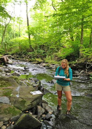 Alex Marcucci assessing a stream during her summer internship with Winooski Natural Resources Conservation District