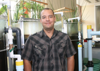 Anthony McInnis, Rubenstein School assistant professor in ecological design next to the Aiken Eco-Machine