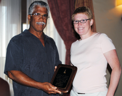 Robert Borrego, M.D., receives the Department of Surgery's award from Elise Everett, M.D.