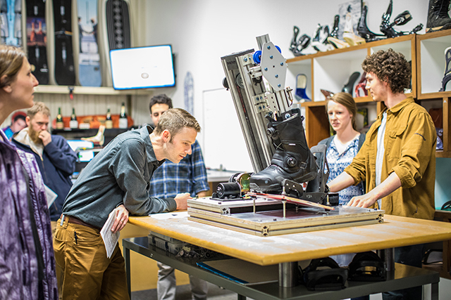 Engineering students show their capstone project to the staff at Burton Snowboards