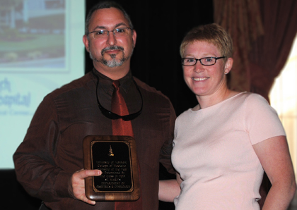 John Caravello, M.D., receives the Department of Obstetrics and Gynecology's award from Elise Everett, M.D.