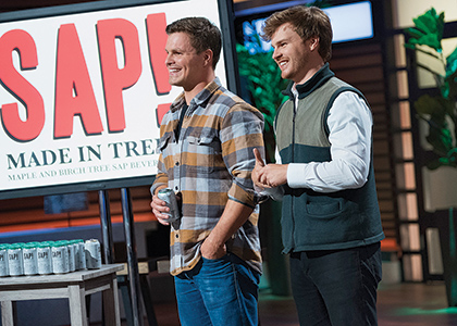 Nikita Salmon and Chas Smith.on the set of Shark Tank making a pitch for their product SAP.
