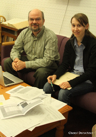 Prof. Conner & research asst. Becot go through papers and results.