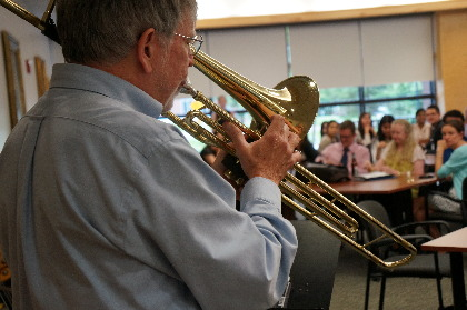 Mitchell Tsai, M.D.'03, assistant professor of anesthesiology and director of OR management and operations at Fletcher Allen, local valve trombonist George Voland, and three other Vermont-based jazz musicians, demonstrate the similarities between leadership in a jazz quartet and leadership among medical teams as part of orientation week for 62 new UVM/Fletcher Allen residents.