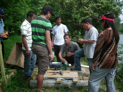 New American Farmers Working Together on the Installation of a Solar Water Pump to Irrigate their Fields