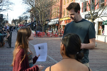 Students talk with Church Street bystander about Human Trafficking