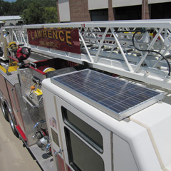 Solar photovoltaic panel on a fire truck in Lawrence, Kansas runs an on-board computer to keep truck from idling during non-emergency stops.