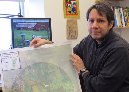 Ernesto Mendez shows a map of a participating farm whose conservation areas are identified.