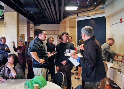 Participants at the Gund Research Slam take a break for discussion.