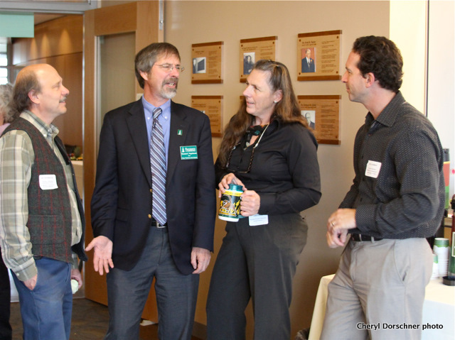 Four scientists get acquainted at Jeffords Hall reception Oct. 18.