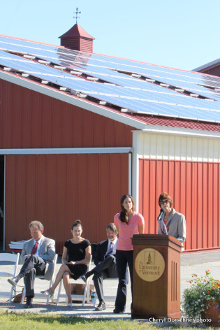 UVM horse barn with solar panels and speakers at unveiling event.