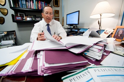 Pediatrics editor-in-chief Lewis First, M.D., holding a weekly