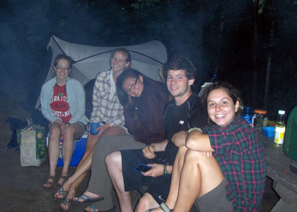 Members of the 2013 LANDS Crew relax by the campfire after a long day in the field.