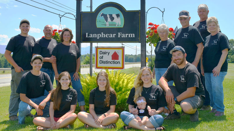 Lanphear family poses by their farm sign