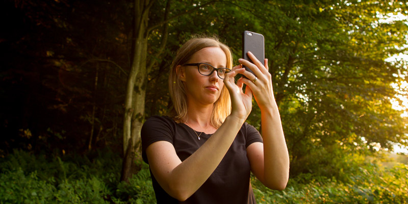 UVM researcher takes a photo outdoors in Vermont.