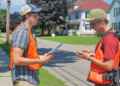 Mike Storace (ENVS) (left) and Kristian Moore (ENVS) inventory trees in Essex Junction, Vermont.