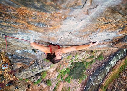 Mo Beck scaling a rock face