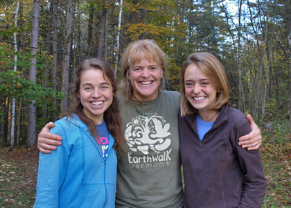 Seniors Bekah Gordon (left) and Lily Morgan pose with Angella Gibbons of Earth Walk Vermont; the pair created an interpretive map of the Earth Walk property for their 206 project.