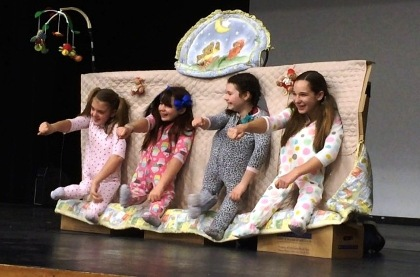 Members of the Starry Nights 4-H Club as dancing babies on stage
