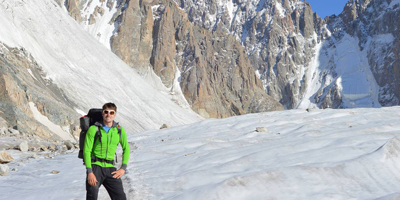 Nathan Fry stands on the Ak Sai Glacier in the Ala Archa National Park, Kyrgyzstan. Photo by Ben Teasdale (UVM '15).
