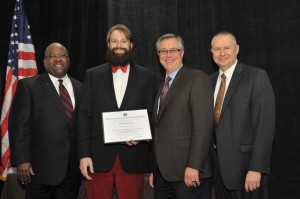 Nathan Reigner receiving award