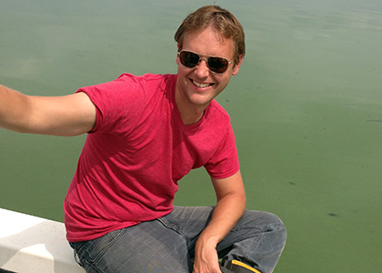 Rubenstein School PhD student Peter Isles conducts his research on Lake Champlain's blue-green algae.