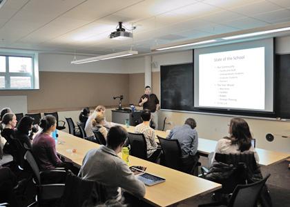 Rubenstein School graduate students attend a State of the School address by Interim Dean Jon Erickson.