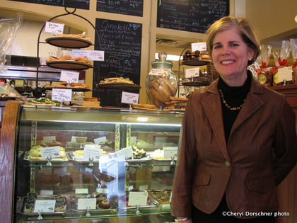 UVM nutritionist Rachel Johnson stands in front of a glass case at an upscale Burlington, Vermont bakery.