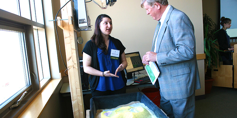 Rachel Seigel demonstrates Automated Reality Sandbox to Vice President for Research Richard Galbraith.