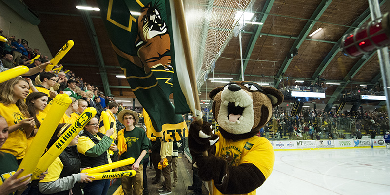 Rally the UVM mascot energizes fans at the UVM Gutterson Field House.