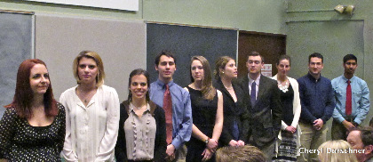 Lineup of bored looking students waiting to get awards.