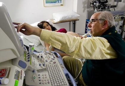 Senior Associate Dean for Research and Chair of Obstetrics, Gynecology & Reproductive Sciences Ira Bernstein, M.D., with a patient at Fletcher Allen Health Care. (Photo by Raj Chawla, UVM Medical Photography)