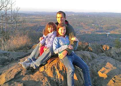 Scott Schwenk and daughters hiking the Holyoke Range in Amherst, MA.