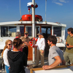 Rubenstein Lab Director Jason Stockwell hosts UVM President Tom Sullivan and wife Leslie Sullivan (far center) on the Research Vessel  Melosira.