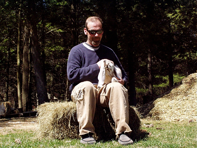 photo of man with goat