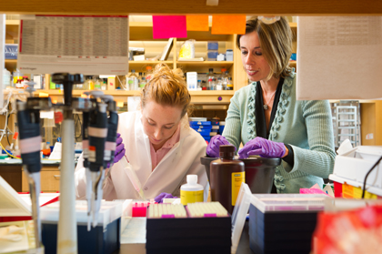 Vermont Cancer Center researcher Yvonne Janssen-Heininger (right) in her lab with a graduate student
