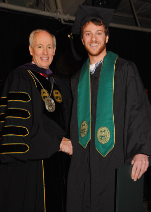 Wyatt Shane (Parks, Recreation & Tourism) of Morrisville, VT receives his diploma from UVM President Tom Sullivan.