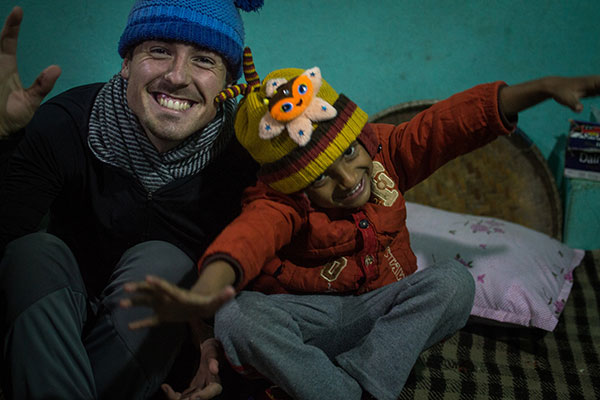 Ben Teasdale '15 with a host family member in Chapagaun, Nepal.