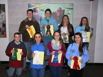 4-H dairy challenge participants with ribbons