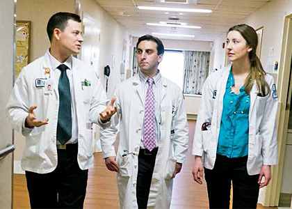 Medical students Kevin Pelletier '15 (at left) and Laurel Wickberg '15 (at right) on rounds with resident Jared Wasser, M.D.
