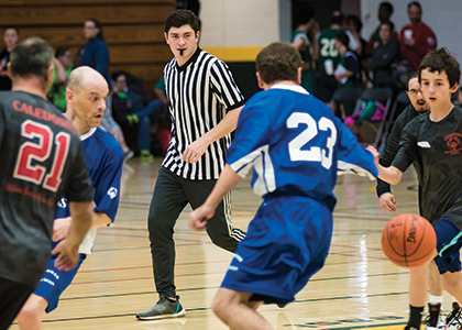 Sam Donnelly refereeing a Special Olympics basketball game