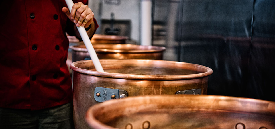 Stirring caramel in vats