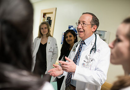 Dr. First leads pediatric rounds on the floor at the UVM Children's Hospital, where he connects students clinically to the basic science they've recently learned.