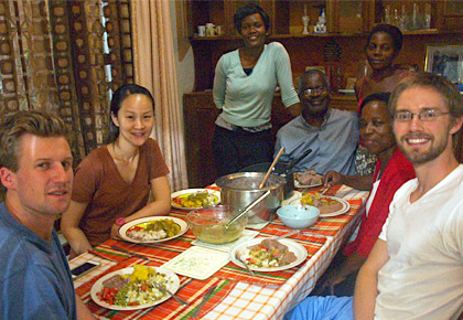 Taylor Goller '16 and Karl Kristiansen eat dinner with the Luboga family during their global health elective in Uganda. Pictured are Dr. Luboga and his wife, Christine, as well as his nieces, Nice and Narissa, and Eunice Fu, a second-year medical student from the University of Connecticut. (Photo courtesy of Majid Sadigh, M.D.)