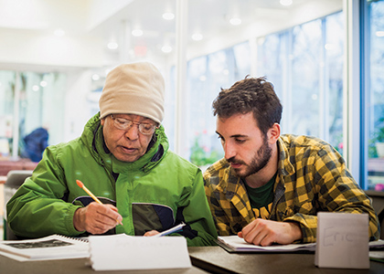 UVM student with Bhutanese man in a citizenship class