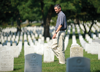 Gregory Huse walking through Arlington Cemetery